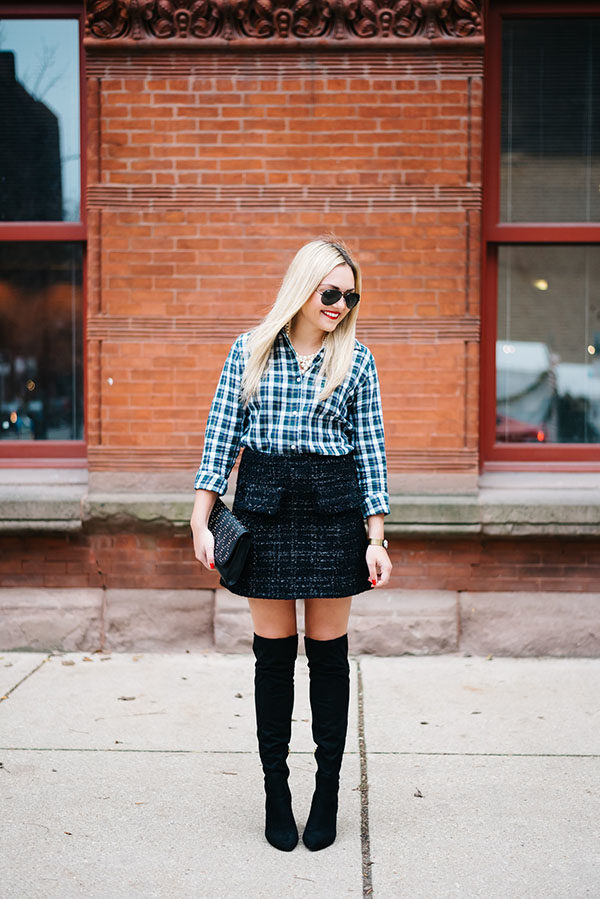 Chicago style blogger Bows & Sequins wearing a plaid shirt with a sparkly tweed skirt and over the knee boots.