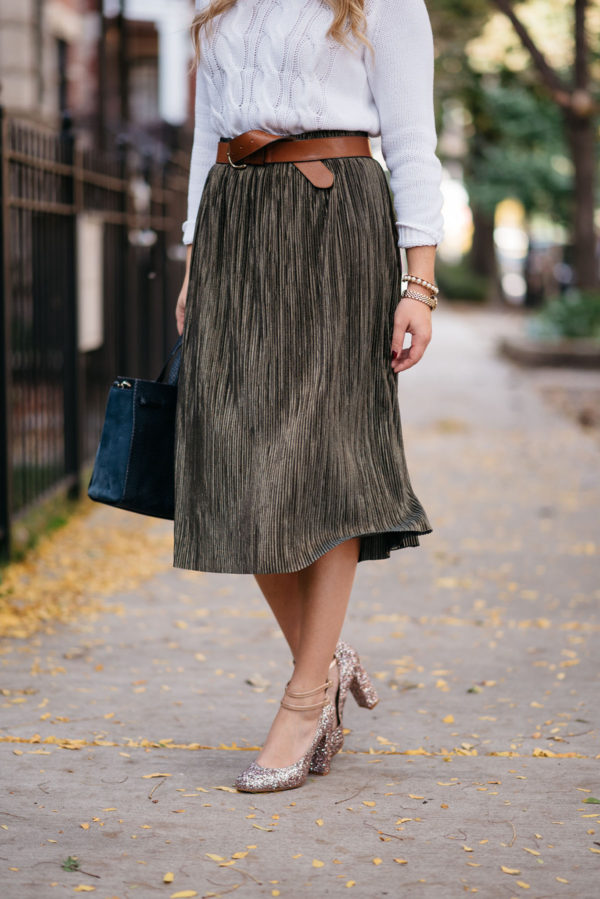 Chicago style blogger Jessica Sturdy of Bows & Sequins wearing a pleated skirt with glitter ankle strap heels.