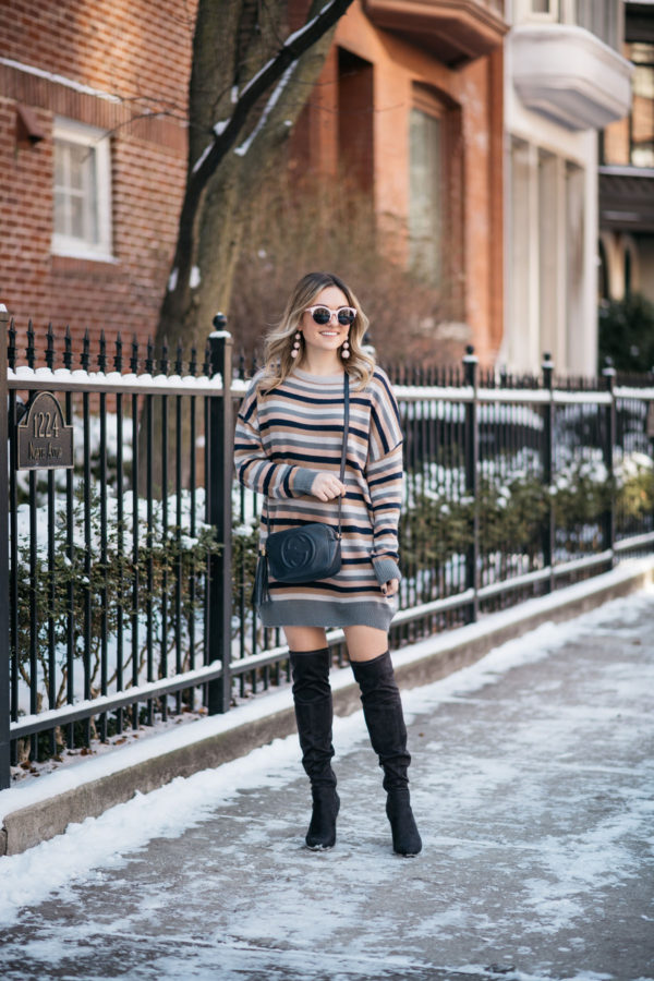 Chicago blog Bows & Sequins wearing a striped sweater dress and over the knee boots.