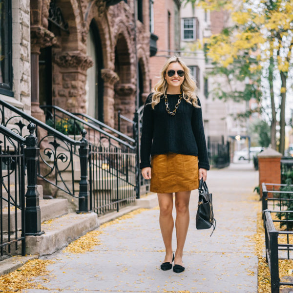 Chicago fashion blog Bows & Sequins wearing a suede skirt and oversized sweater during the fall in Gold Coast.
