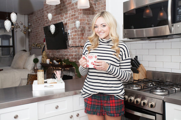 Jessica Sturdy wearing a striped turtleneck and plaid PJ shorts for Christmas in NYC