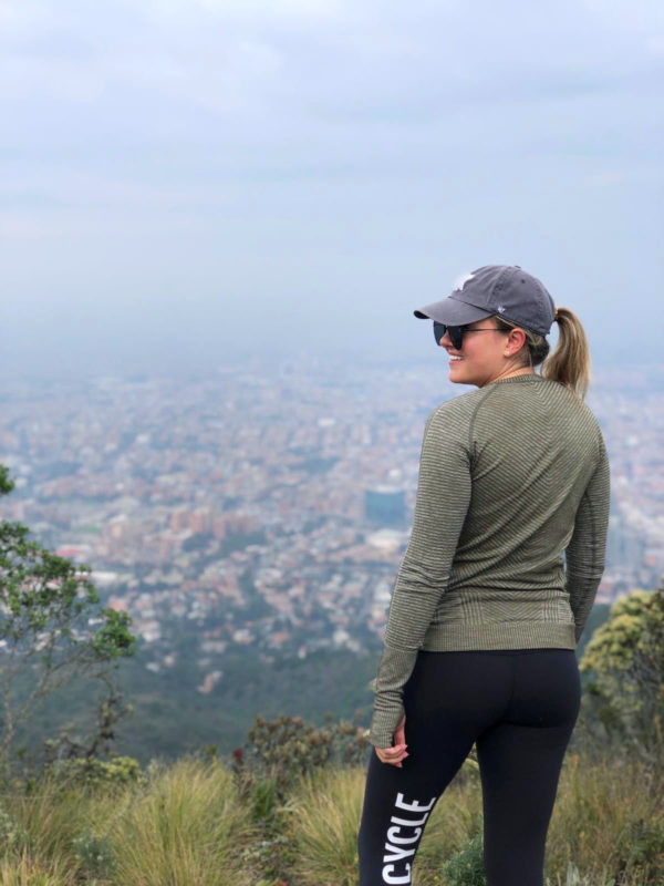 Remote Year blogger Jessica Sturdy in Bogota, Colombia on the top of a mountain overlooking the city after a morning hike.