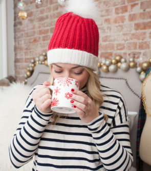 Jessica Sturdy wearing a Kate Spade Santa Hat in her apartment in New York City.