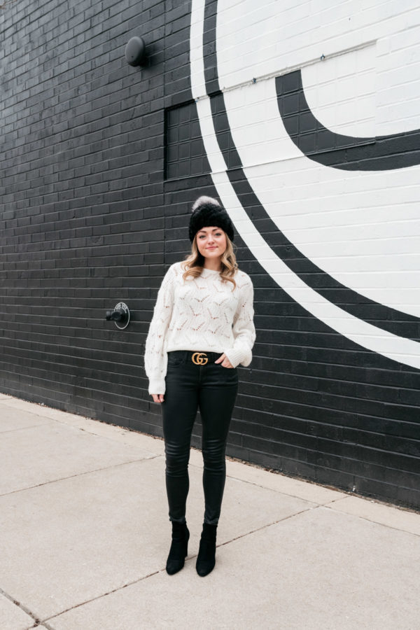 Travel and lifestyle blogger Jessica Sturdy styling a Gucci belt wax coated jeans in Chicago.