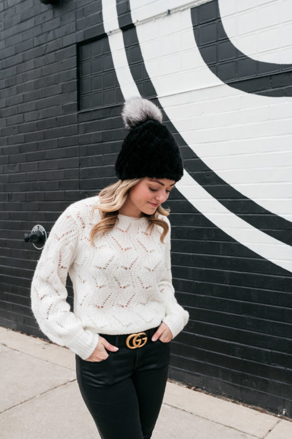 Chicago stylist Jessica Sturdy wearing a simple black and white outfit elevated with a textured hat and Gucci logo belt.