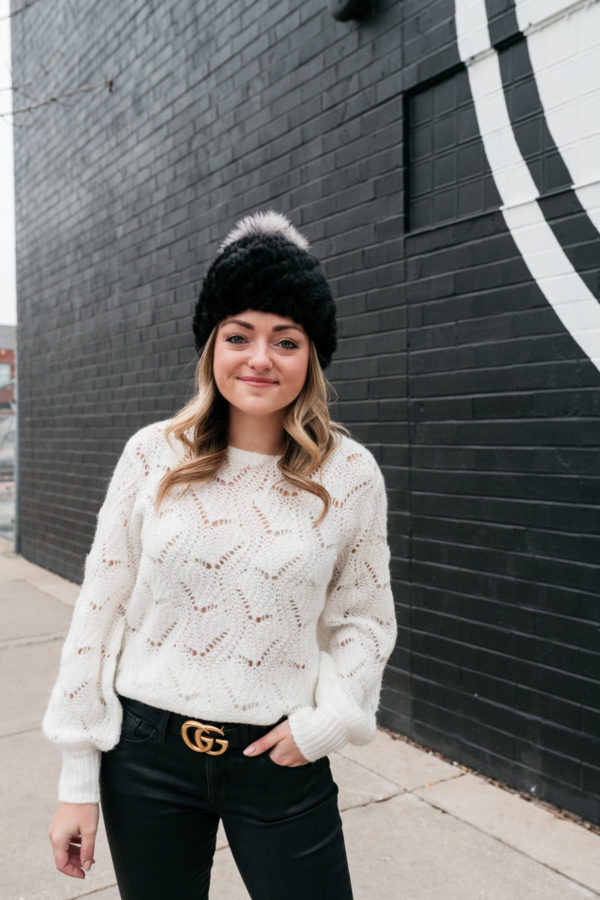 215787d25d942 Chicago-based fashion blogger Jessica Sturdy wearing a black fur beanie by Kyi  Kyi