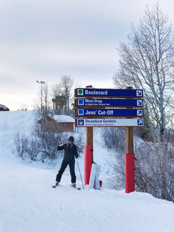 Travel and lifestyle influencer skiing in Steamboat Springs, Colorado.
