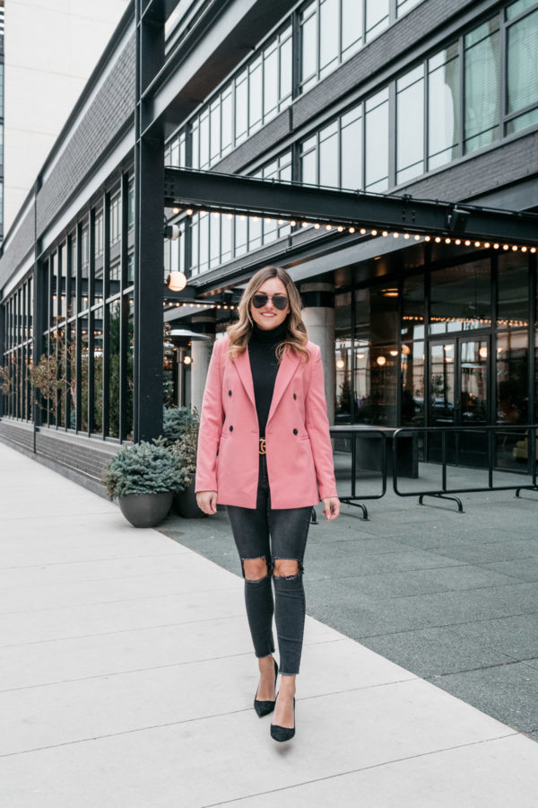 Everyday fashion influencer Jessica Sturdy shares a winter workwear outfit in front of the Ace Hotel in Chicago.