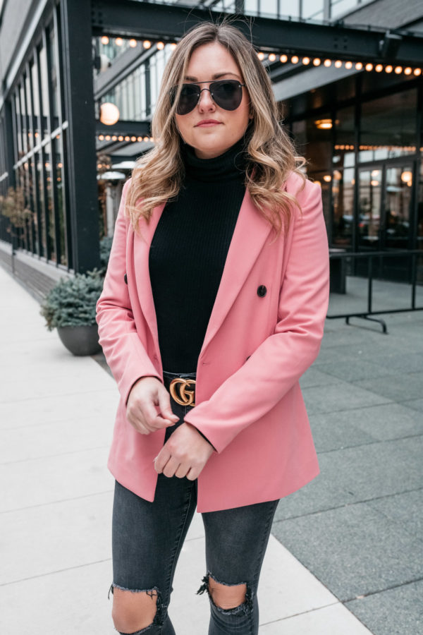 Chicago lifestyle blogger Bows & Sequins wearing a pink boyfriend blazer with a turtleneck and a Gucci belt.