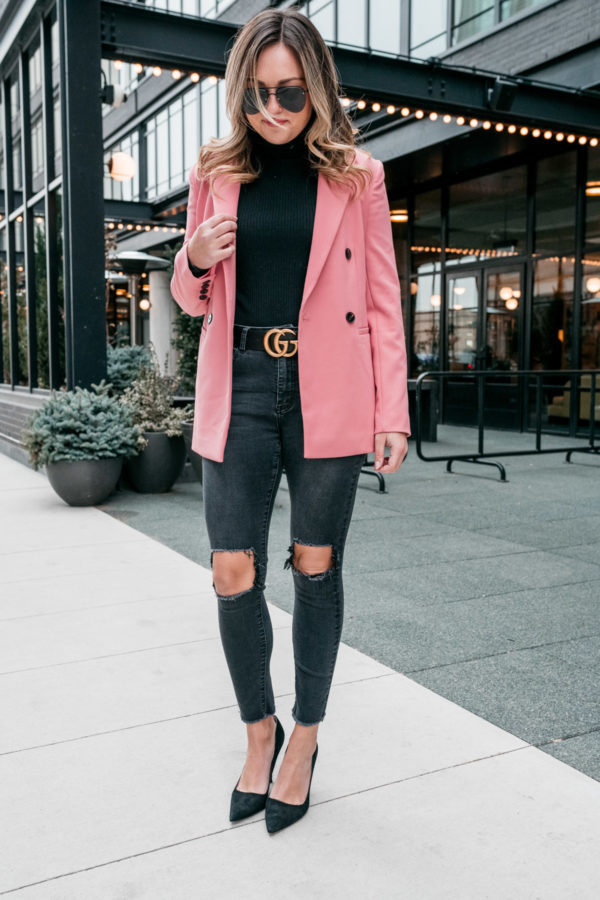 Chicago fashion blogger Jessica Sturdy styles a long pink blazer from Nordstrom with a bodysuit from J.Crew, ripped jeans from Revolve, pointed pumps from Kate Spade, and a Gucci belt.