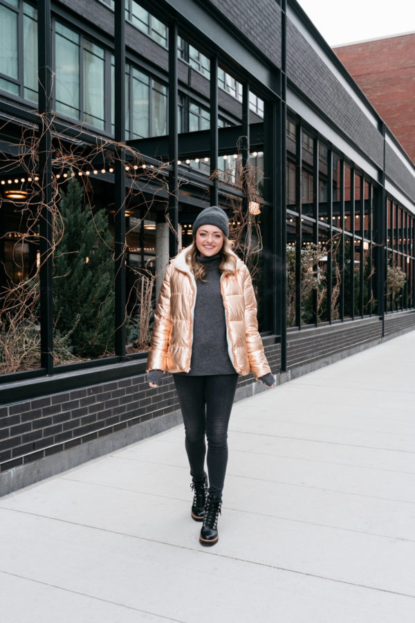 Midwest influencer Bows & Sequins wearing a warm winter outfit in front of the Ace Hotel in the West Loop in Chicago.