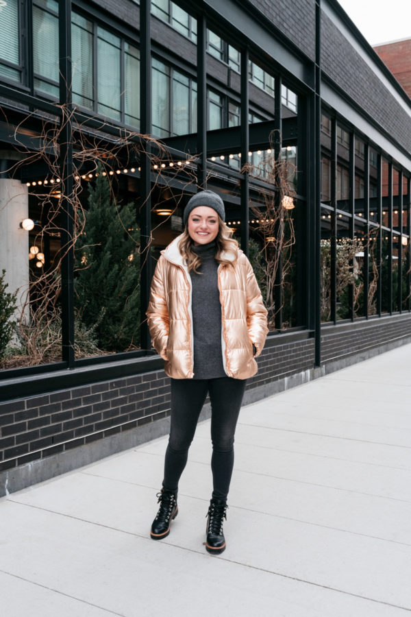 Chicago wellness blogger Jessica Sturdy wearing a rose gold puffer jacket.