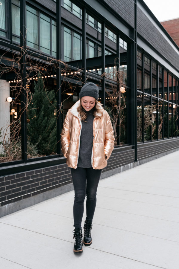 Midwest blogger Bows & Sequins wearing a bronze puffer coat with a turtleneck and beanie.