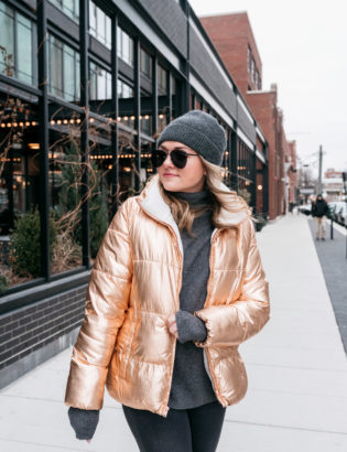 Chicago-based fashion blogger Jessica Sturdy wearing a metallic coat with Le Specs Matte Black Prince Aviators.