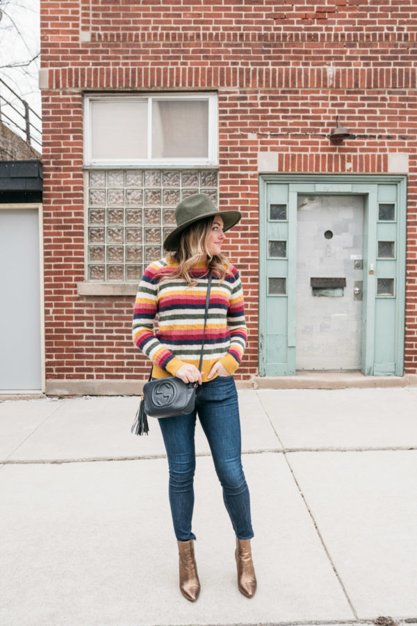 Chicago fashion blogger Jessica Sturdy wearing a cashmere striped sweater, Rag & Bone jeans, and metallic ankle booties.