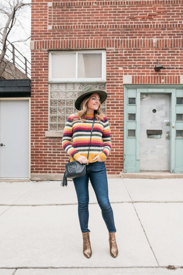 Chicago personal shopper Jessica Sturdy wearing a colorful cashmere sweater with metallic booties.