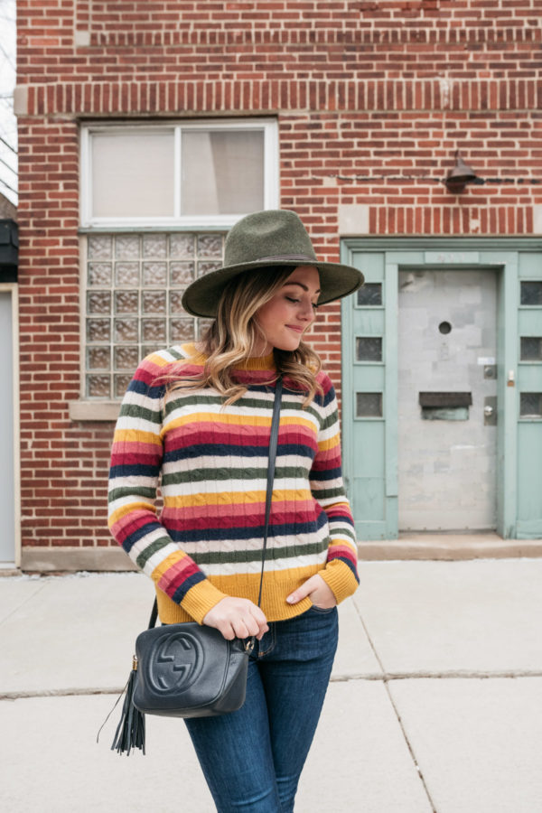 Chicago wardrobe consultant Jessica Sturdy wearing an olive green Barbour hat with a colorful cashmere stripe sweater.
