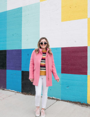 Chicago blogger Jessica Sturdy of Bows & Sequins styles a striped cashmere sweater with white jeans, blush pink suede sneakers, and a J.Crew cocoon coat.