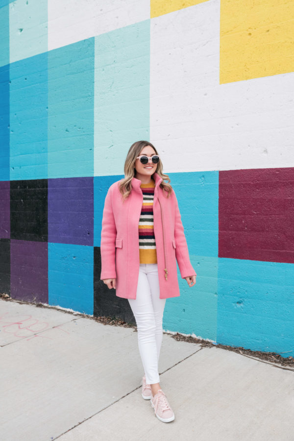 Chicago fashion blogger Jessica Sturdy of Bows & Sequins styles a pink J.Crew cocoon coat with white jeans from Old Navy.
