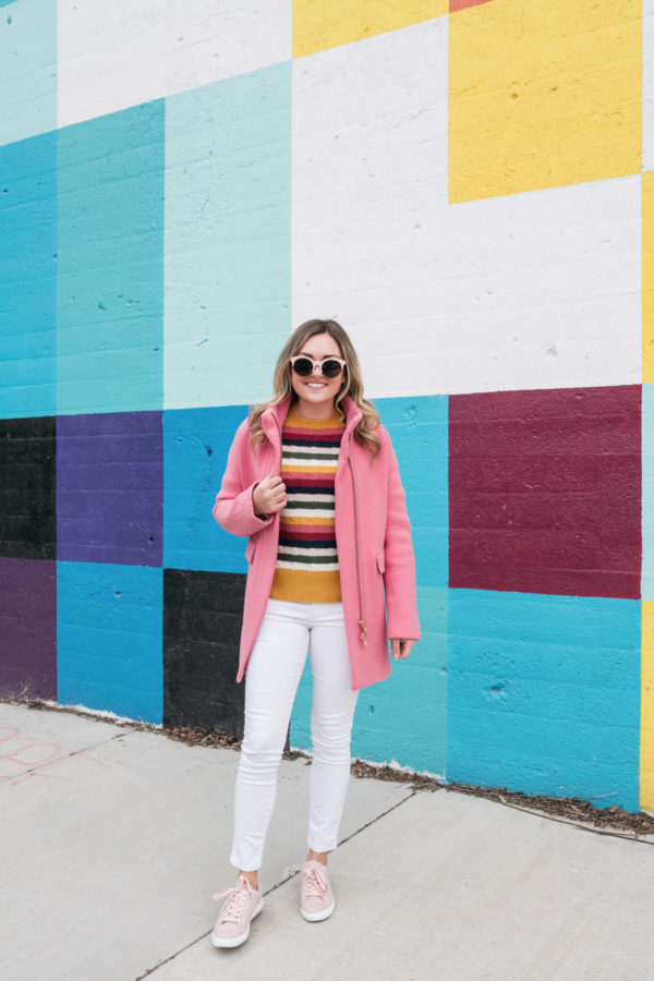 Chicago lifestyle blogger Jessica Sturdy of Bows & Sequins styles a hot pink coat with white jeans for a casual winter outfit.