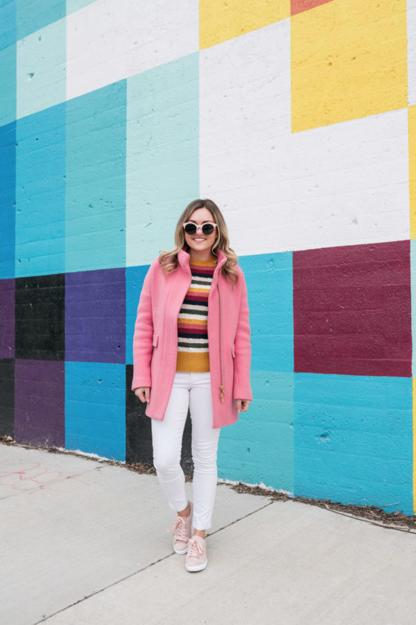 Chicago travel blogger Jessica Sturdy of Bows & Sequins styling white denim in the winter with pink sneakers.