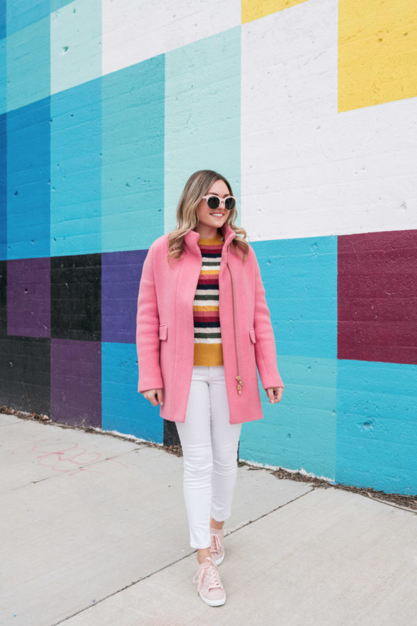 Chicago health and wellness blogger Jessica Sturdy of Bows & Sequins styling a pink coat with white jeans in the winter.
