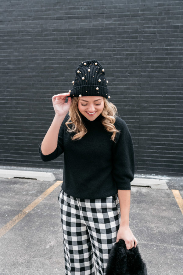 Chicago fashion blogger Bows & Sequins styling a pearl beanie with a sweater and gingham trousers.