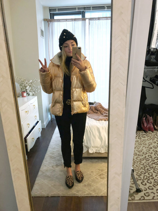 Jessica Sturdy styles a metallic puffer jacket with a Gucci belt, pearl beanie, and leopard slides.
