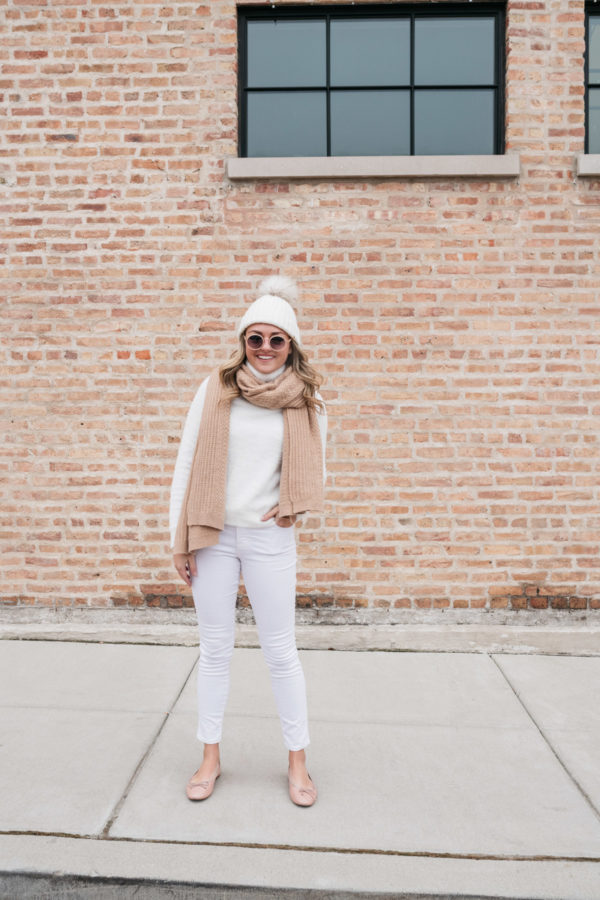 Jessica Sturdy styling a pair of white jeans in the winter.