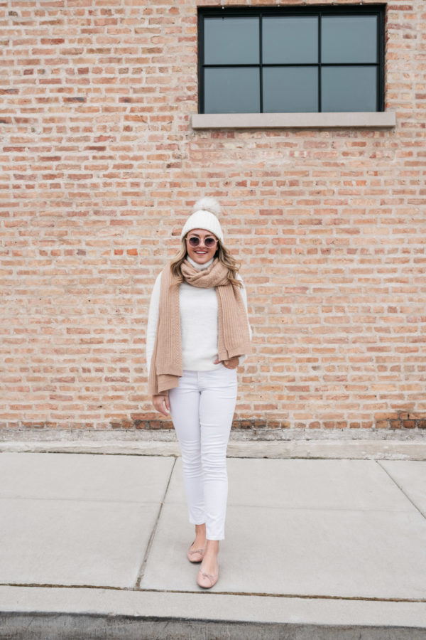 Chicago fashion blogger Jessica Sturdy styles an outfit with white jeans and a turtleneck.