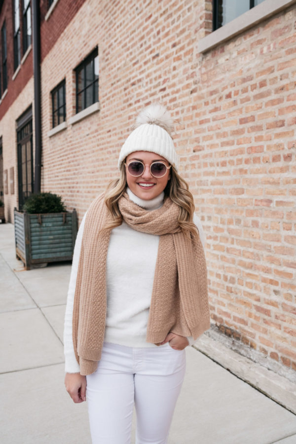 Top Chicago lifestyle influencer and blogger Jessica Sturdy styling a chic winter white outfit.
