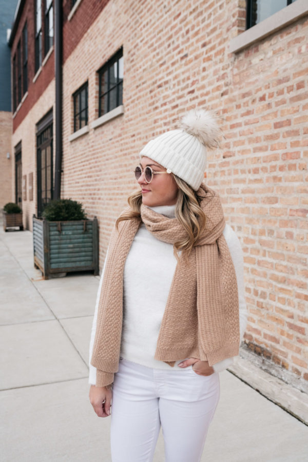 Chicago lifestyle blogger Jessica Sturdy wearing a white pom pom fur beanie with a monochromatic white outfit.