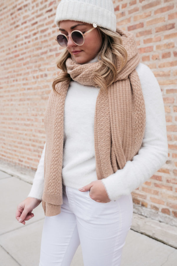 Chicago style blogger wearing a white turtleneck with a camel colored cashmere scarf.