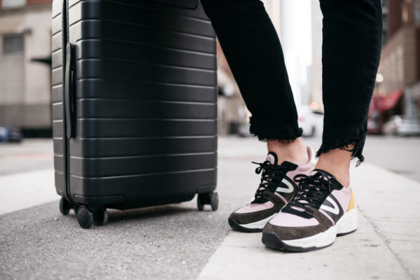 Bows & Sequins styling dad sneakers for a comfortable travel outfit.