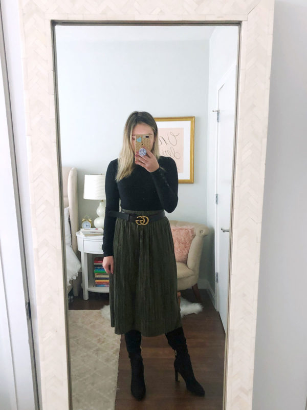 Bows & Sequins styling a gucci belt with a pleated skirt and over the knee boots.