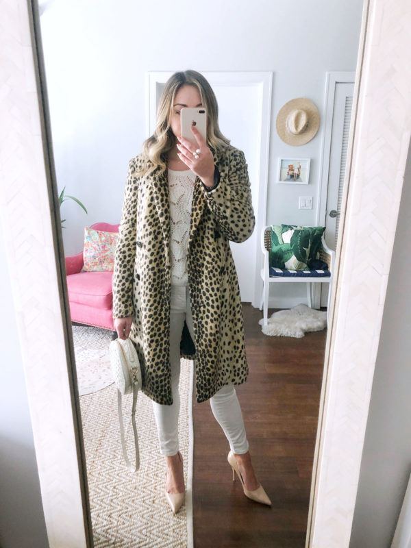 Fashion blogger Jessica Sturdy of Bows & Sequins styling a leopard coat with an all white outfit and a round circle bag.