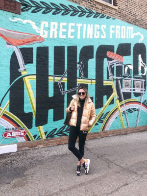 Chicago blogger Jessica Sturdy in front of Greetings from Chicago mural at Heritage Bicycles in Lakeview.