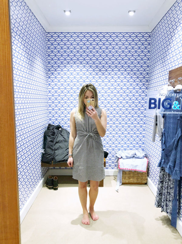 Chicago blogger Bows & Sequins trying on a gingham dress from Vineyard Vines.