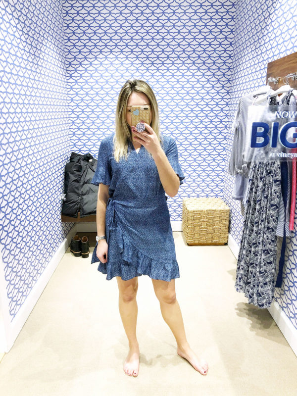 Chicago lifestyle influencer Bows & Sequins doing a Vineyard Vines dressing room try-on at Vineyard Vines wearing a printed wrap dress.