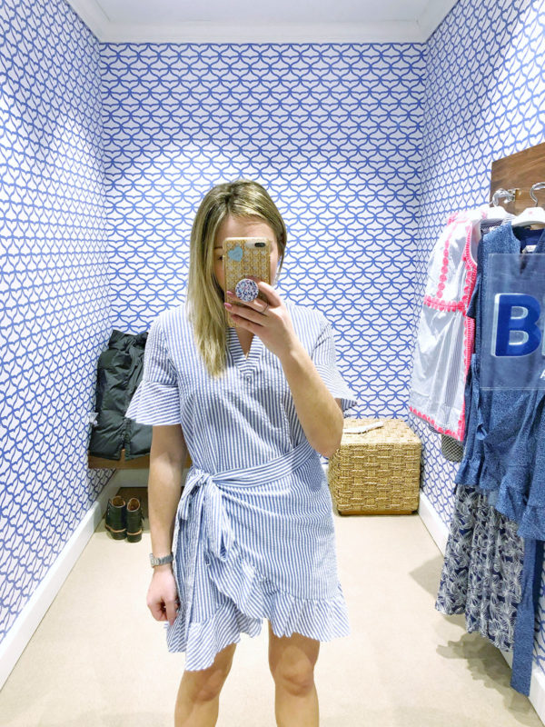 Chicago fashion influencer Jessica Sturdy trying on a seersucker wrap dress at Vineyard Vines -- a must for spring and summer!