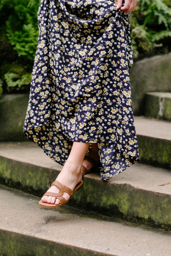 Circus by Sam Edelman Betty braided leather slide sandals styled with a floral maxi dress.