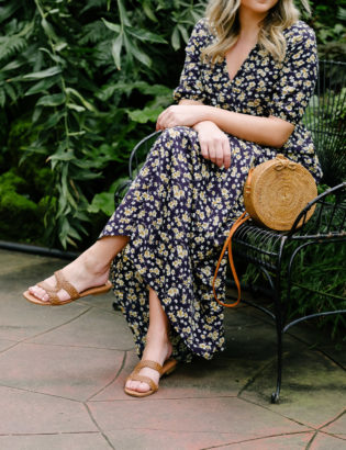 Chicago blogger Bows & Sequins styling Sam Edelman sandals, a floral maxi dress, and a round wicker bag.