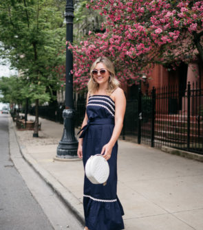 Chicago fashion influencer Jessica Sturdy of Bows & Sequins wearing a navy blue ric rac maxi dress.