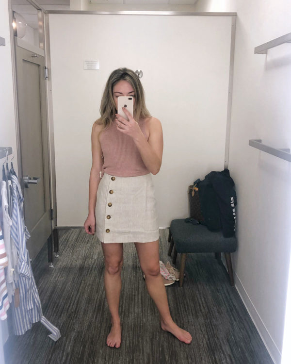 Fashion blogger styling a sleeveless sweater and linen skirt from Reformation