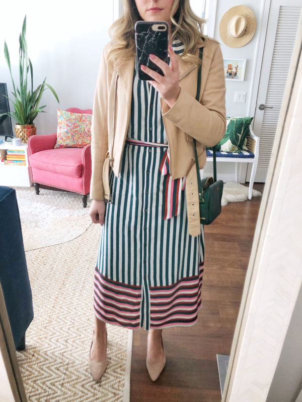 Chicago fashion influencer Jessica Sturdy of Bows & Sequins styling a Sandro nude leather jacket with a Boden striped shirt dress, nude suede pumps, and a monogrammed green crossbody bag for a spring bridal shower.
