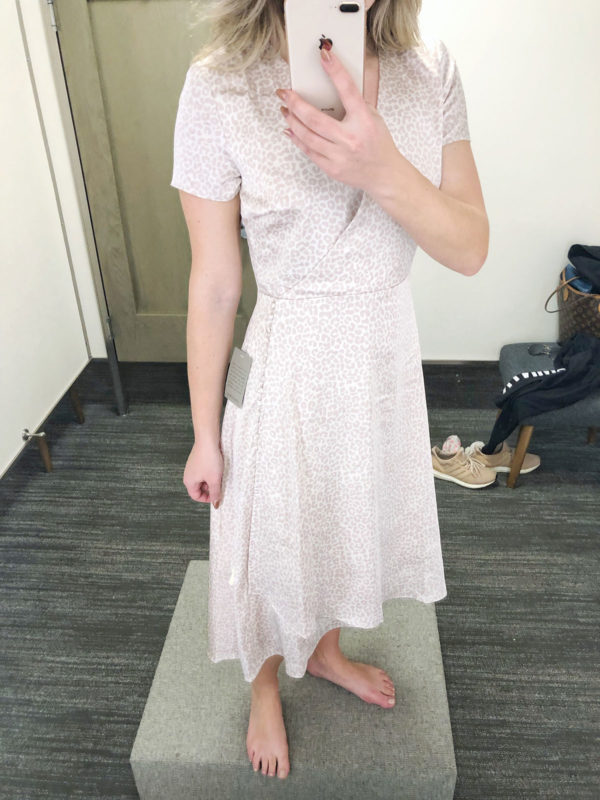 Fashion blogger trying on a silk midi dress at Nordstrom