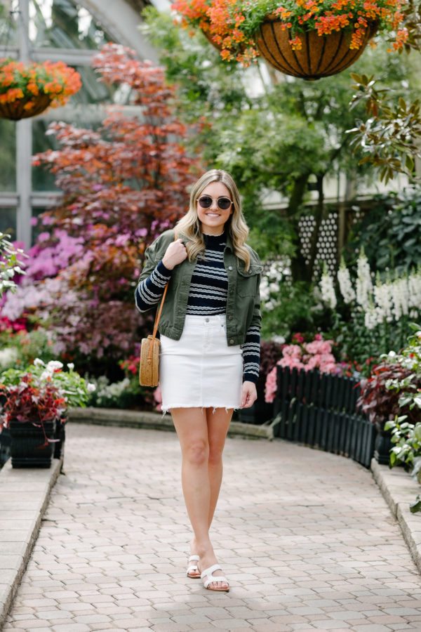 Jessica Sturdy styling a white denim skirt with a green army jacket.
