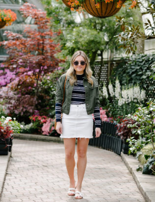 Chicago fashion blogger Bows & Sequins wearing a white denim skirt with a blue and white striped top.