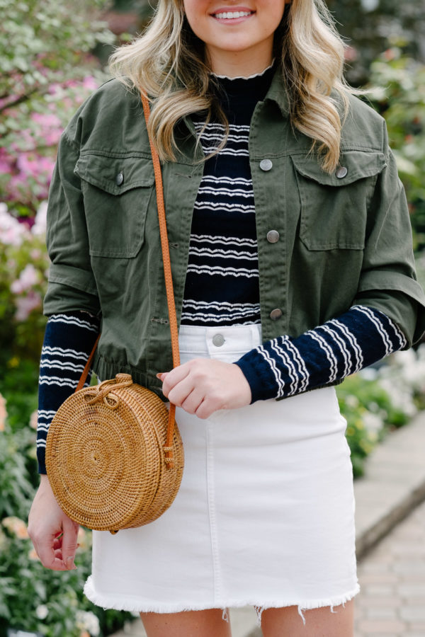 Chicago fashion blogger Bows & Sequins styling a round rattan bag for spring.