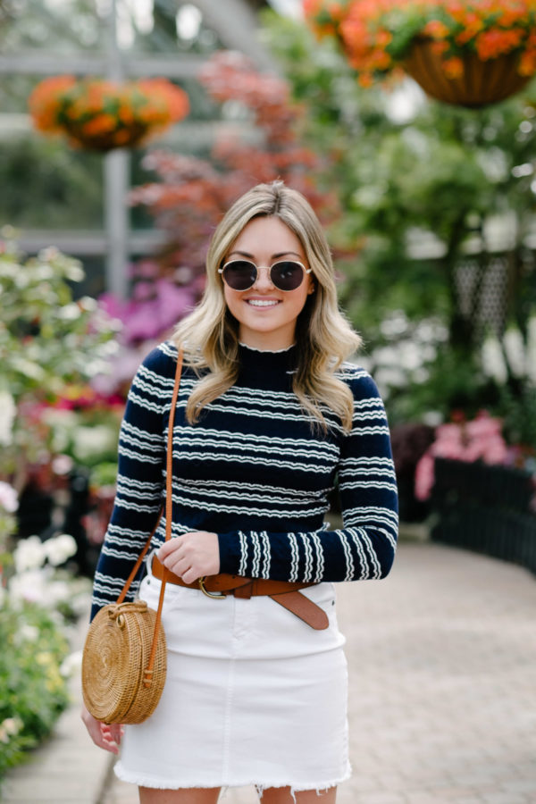 Chicago fashion and beauty blogger Bows & Sequins wearing Prive Rivaux sunglasses and a long sleeved striped top from Miss Selfridges.